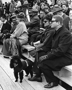 Spectators watch a football game, 1963