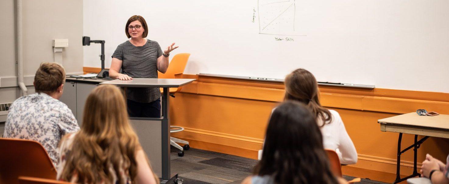teacher in a classroom teaching students