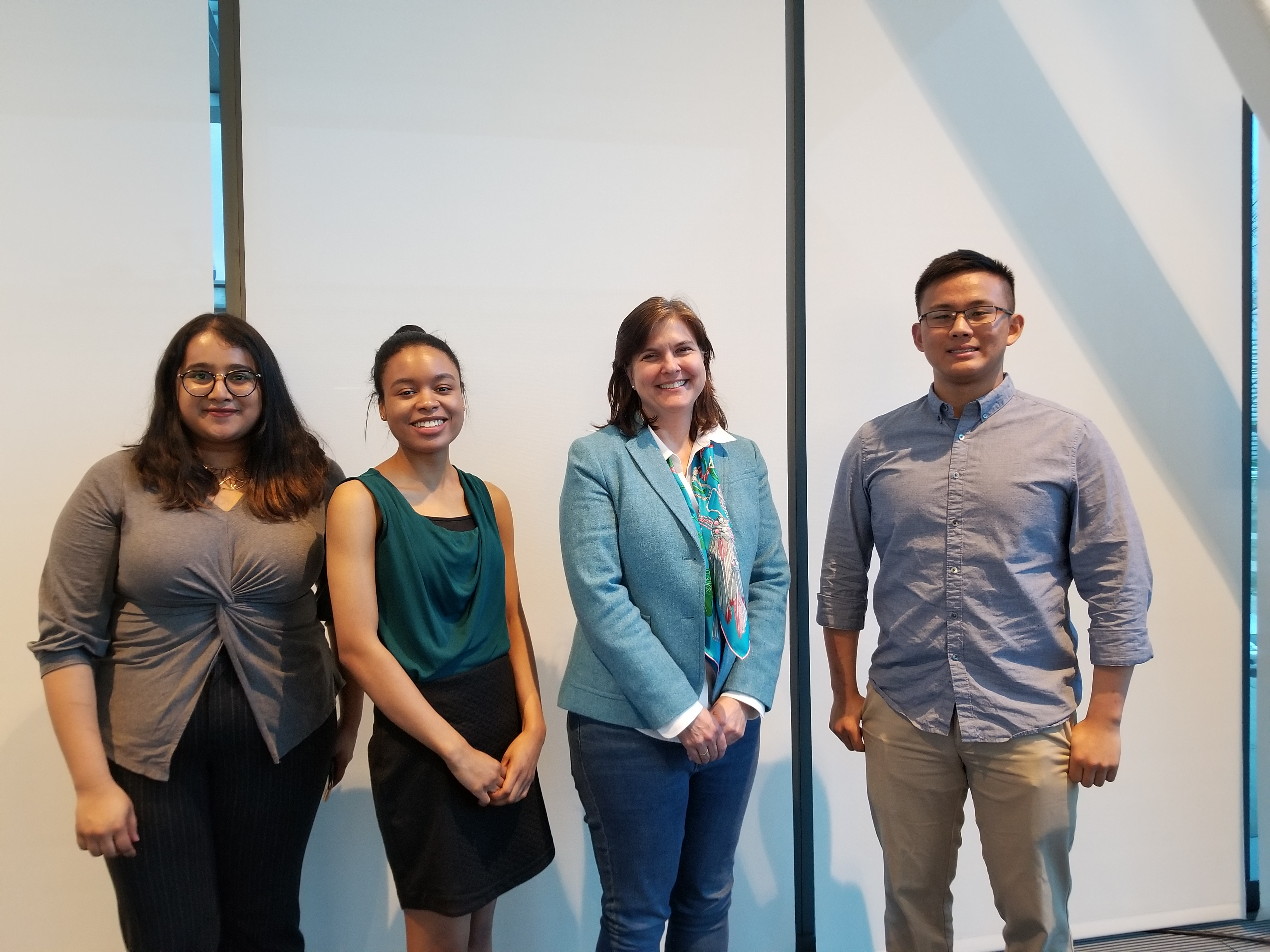 Professor Kathryn Lavelle with her advisees, Ari Menon, Amanda Smith, and Yujie Hu.