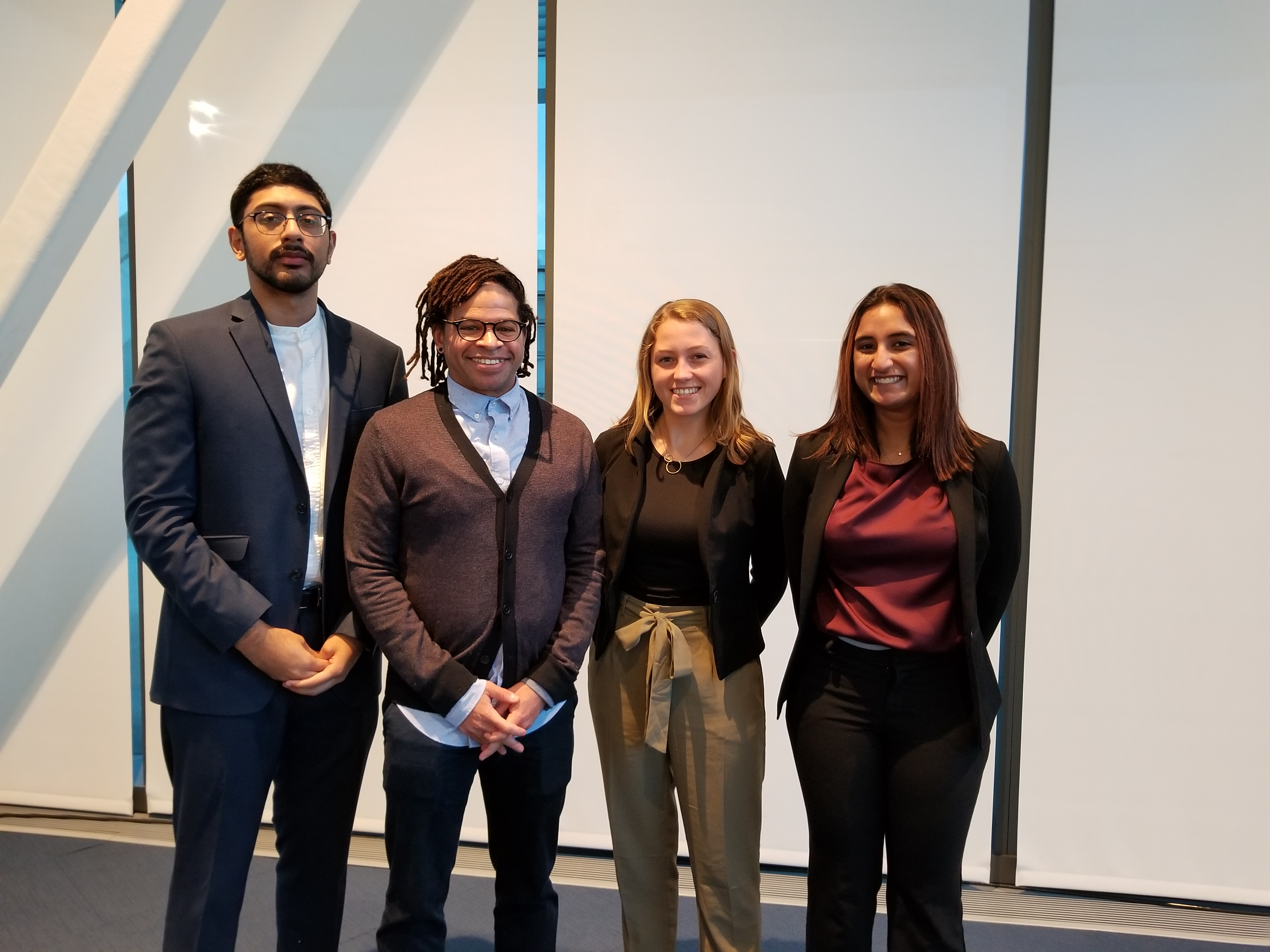 Professor Girma Parris and his advisees, Vishnu Akella, Marin Exler, and Sneha Darbha.