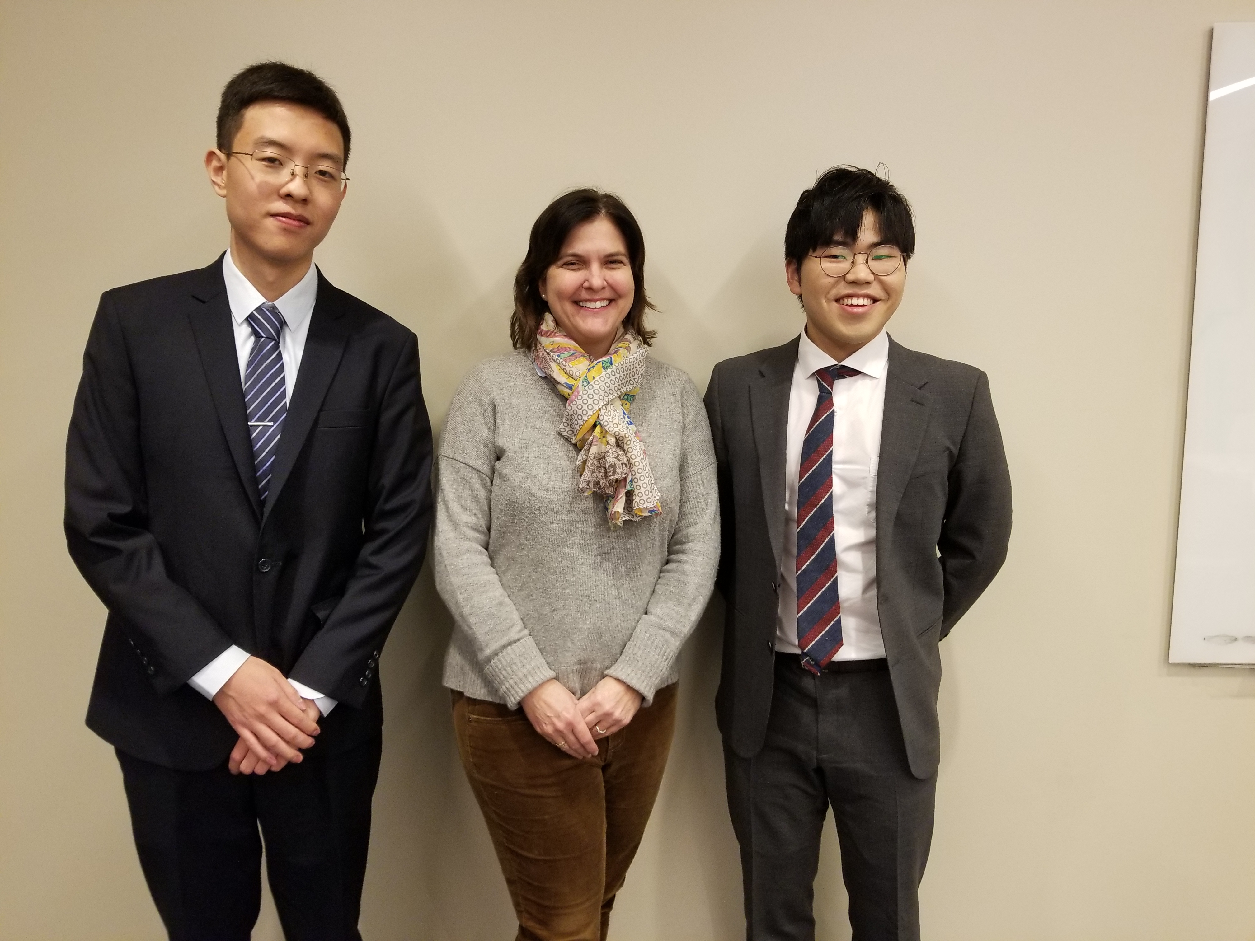 Professor Kathryn Lavelle with her two advisees, Lance Zhong and Yoon Lee