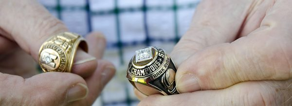 Among Ryan's keepsakes from his football career are the 1964 NFL Championship ring he earned with the Cleveland Browns (right) and the 1957 Southwest Conference Championship ring he earned at Rice. Photo by Nancy Nutile-McMenemy.