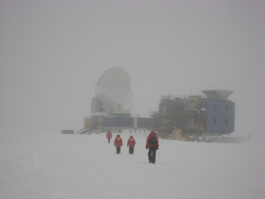 The Antarctic sky is not always bright and clear. On stormy days, it's a challenging trek from the Amundsen-Scott South Pole Station to the telescope a mile away. Courtesy of John Ruhl.