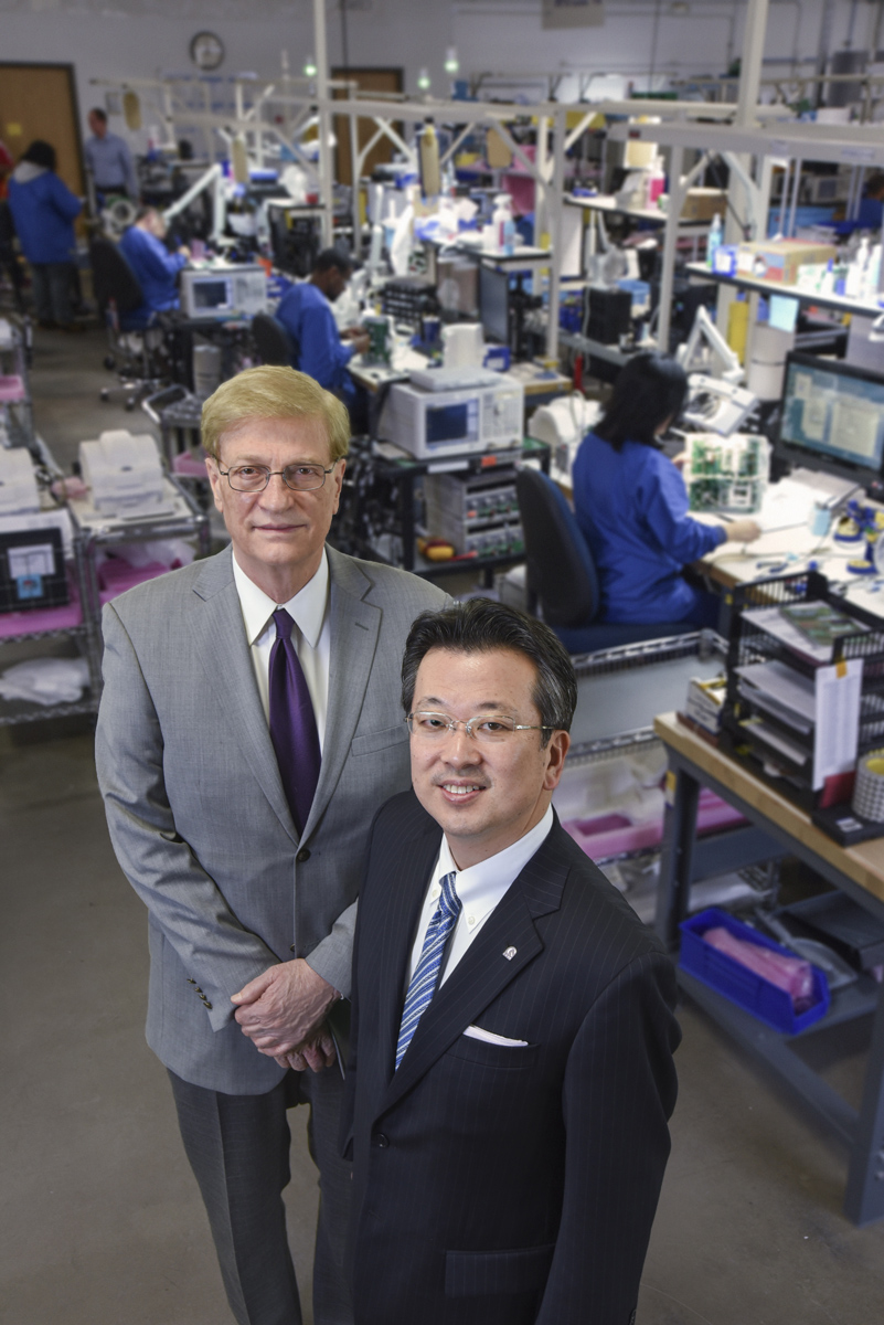 Robert Brown (left) has helped several of his former students establish medical technology companies. Hiroyuki Fujita (right) is the founder, president and CEO of Quality Electrodynamics (QED), a manufacturer of radiofrequency coils for MRI machines. Since it opened in 2006, QED has grown rapidly; it has more than 150 employees and occupies a 77,000-square-foot facility in Mayfield Village, Ohio. Photo by Mike Sands.