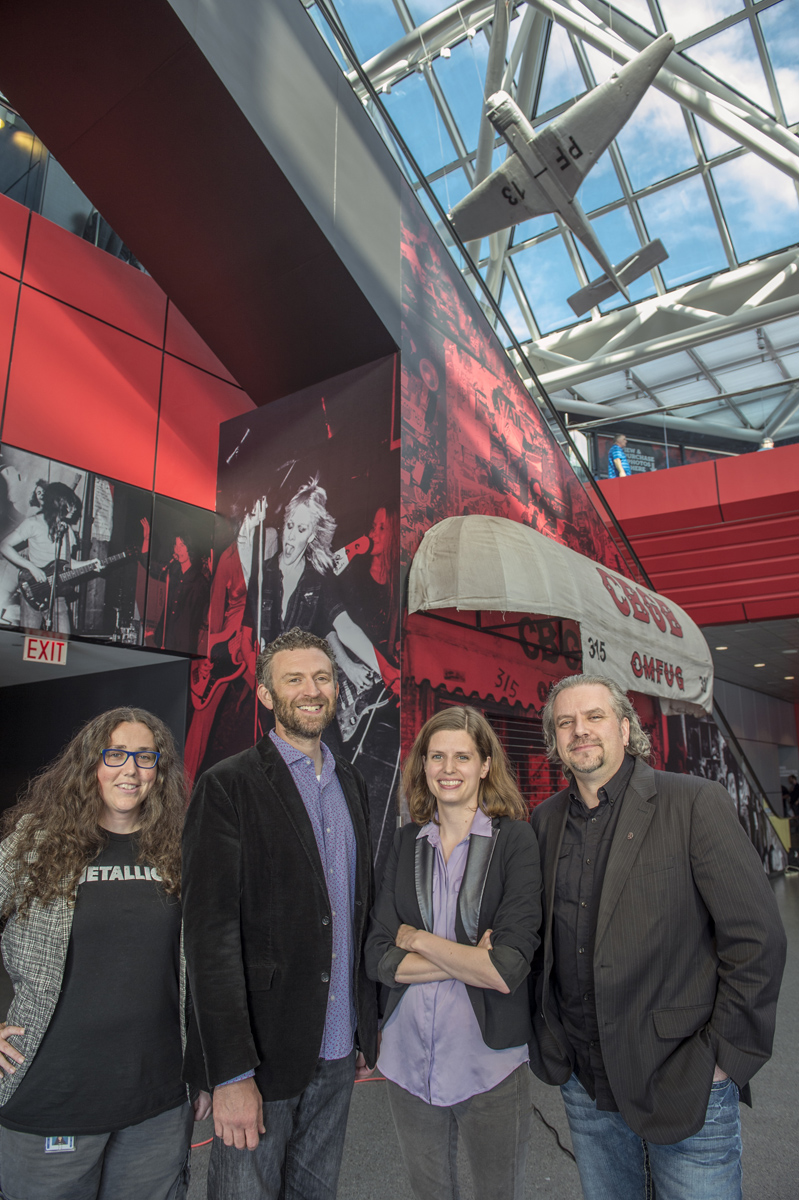 From left: The collaboration between Case Western Reserve and the Rock and Roll Hall of Fame and Museum has brought together doctoral student Mandy Smith, Professor Daniel Goldmark, doctoral student Leah Branstetter and Jason Hanley, the Rock Hall's vice president of education and visitor engagement. Photo by Robert Muller.