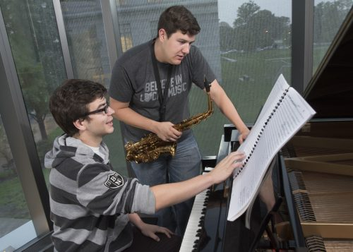 Kemeny (left) invited friend and bandmate Ryan Rose to perform as the soloist for his concerto's premiere. The two students often conferred while Kemeny was writing the piece. Photo by Mike Sands.