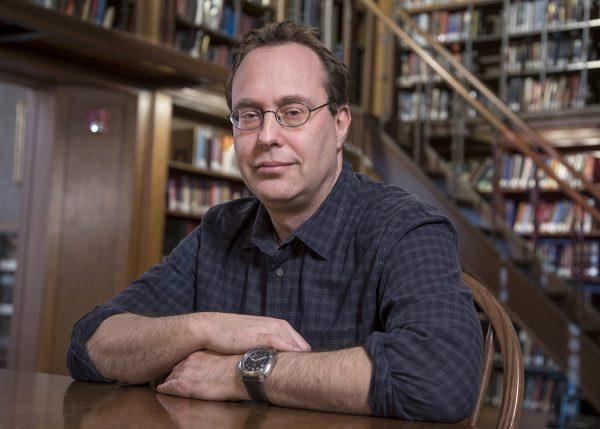 Historian at library desk