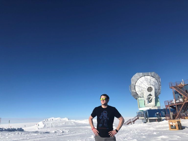 """From Allen's blog: Jan. 8 - Day 9 on Ice. Allen standing outside the Dark Sector Lab (DSL) which contains SPT on a """"warm"""", roughly -12F day, with a slight breeze."""