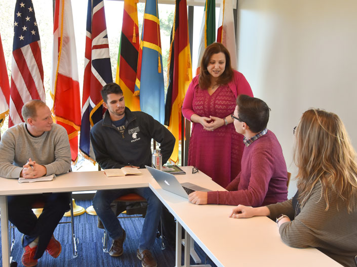 case western reserve university military ethics masters degree students in a classroom talking to a faculty member