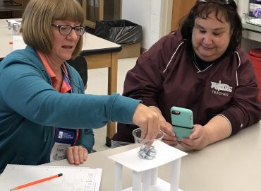 Teachers testing bridges
