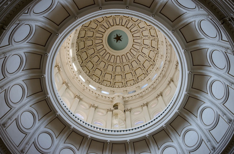 a photograph looking upwards into the state capitol dome