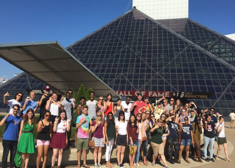 Summer on the Cuyahoga participants standing in front of the Rock Hall