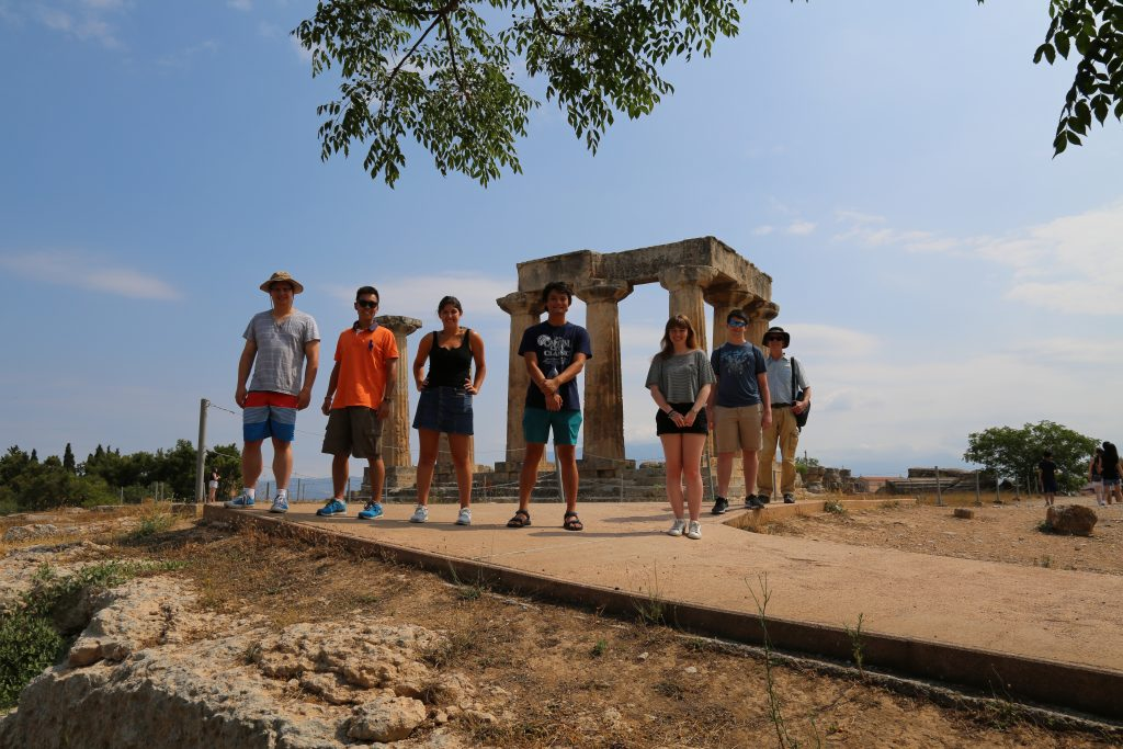 Students (from right to left) Bronson, Alexander, Rio, Josh, Samantha, David, and Professor Iversen at the temple on Temple Hill, Corinth.