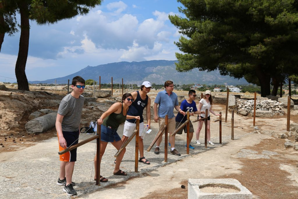 Students (from left to right) David, Rio, Joshua, Bronson, Alexander, and Samantha at the starting gate at ancient Isthmia.