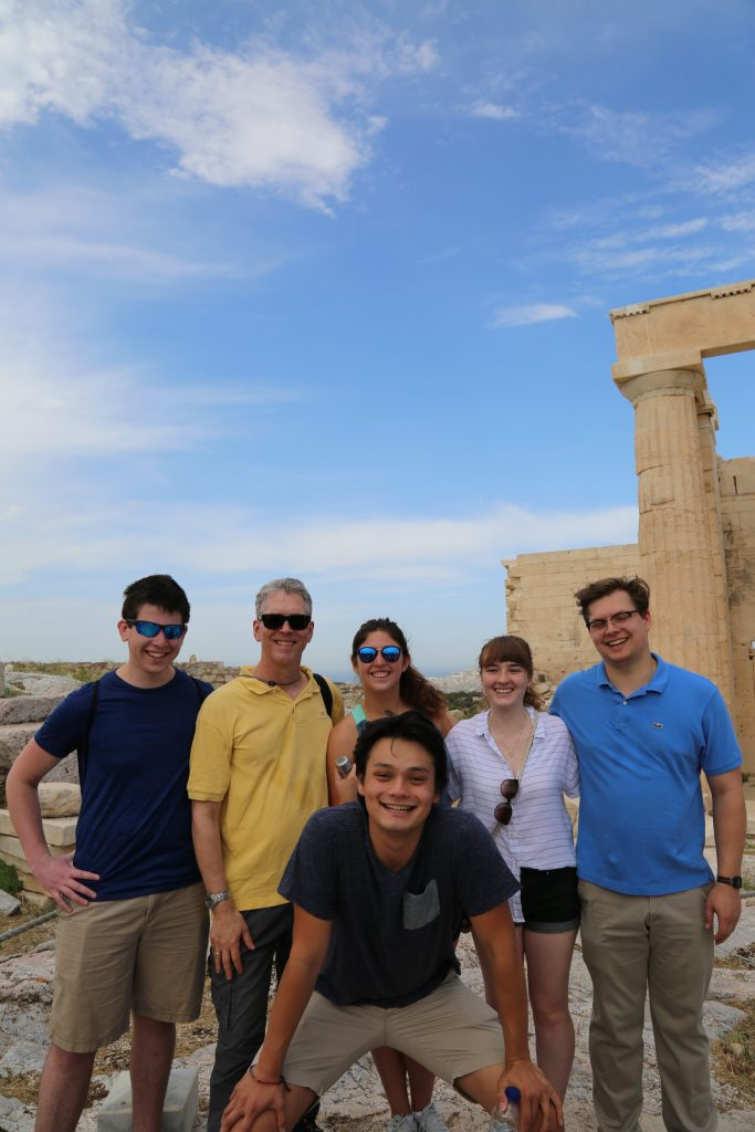 Posing with a piece of the Propylaea on the Athenian Acropolis in the background. From left to right: David, Professor Iversen, Joshua (front), Rio (back), Samantha, Bronson