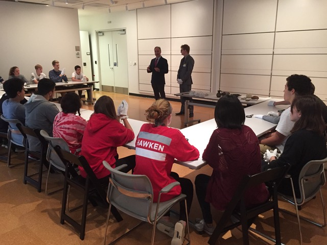Students handle ancient objects in the Cleveland Museum of Art