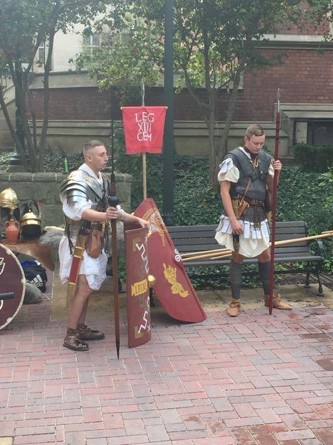 Reenactors from Legio XIIII Gemina strike camp outside Clark Hall