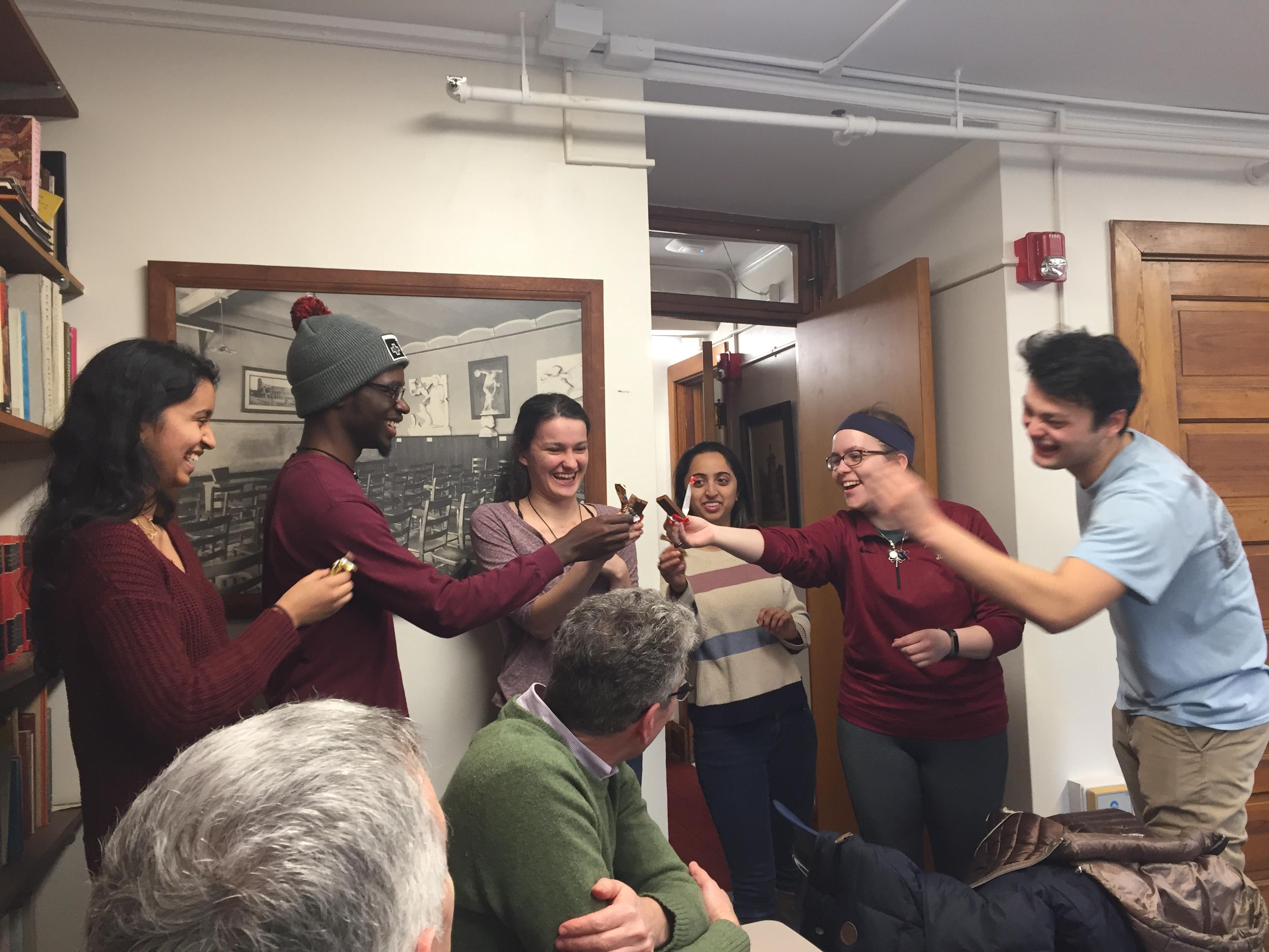 New members of Eta Sigma Phi celebrate with a candy toast (from L to R: Asha Ravichadran, Nana Yorke, Jillian White, Saloni Lad, Emma Ries, and Joshua Breckenridge).