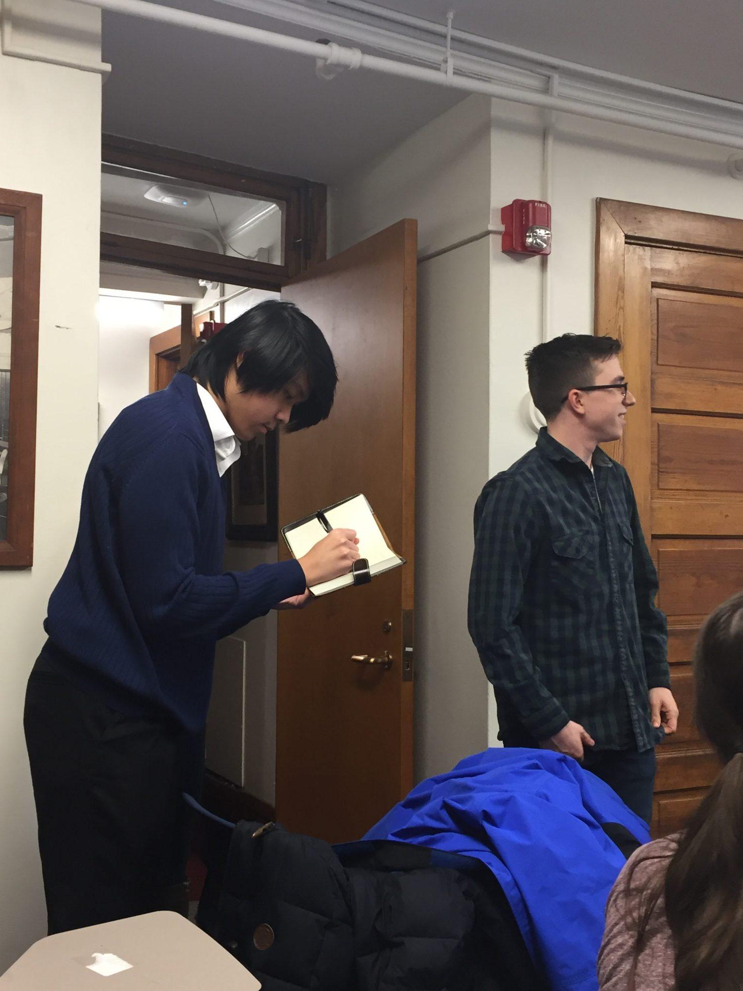 Jacob Kordeleski inducts Nam Vo into Eta Sigma Phi.