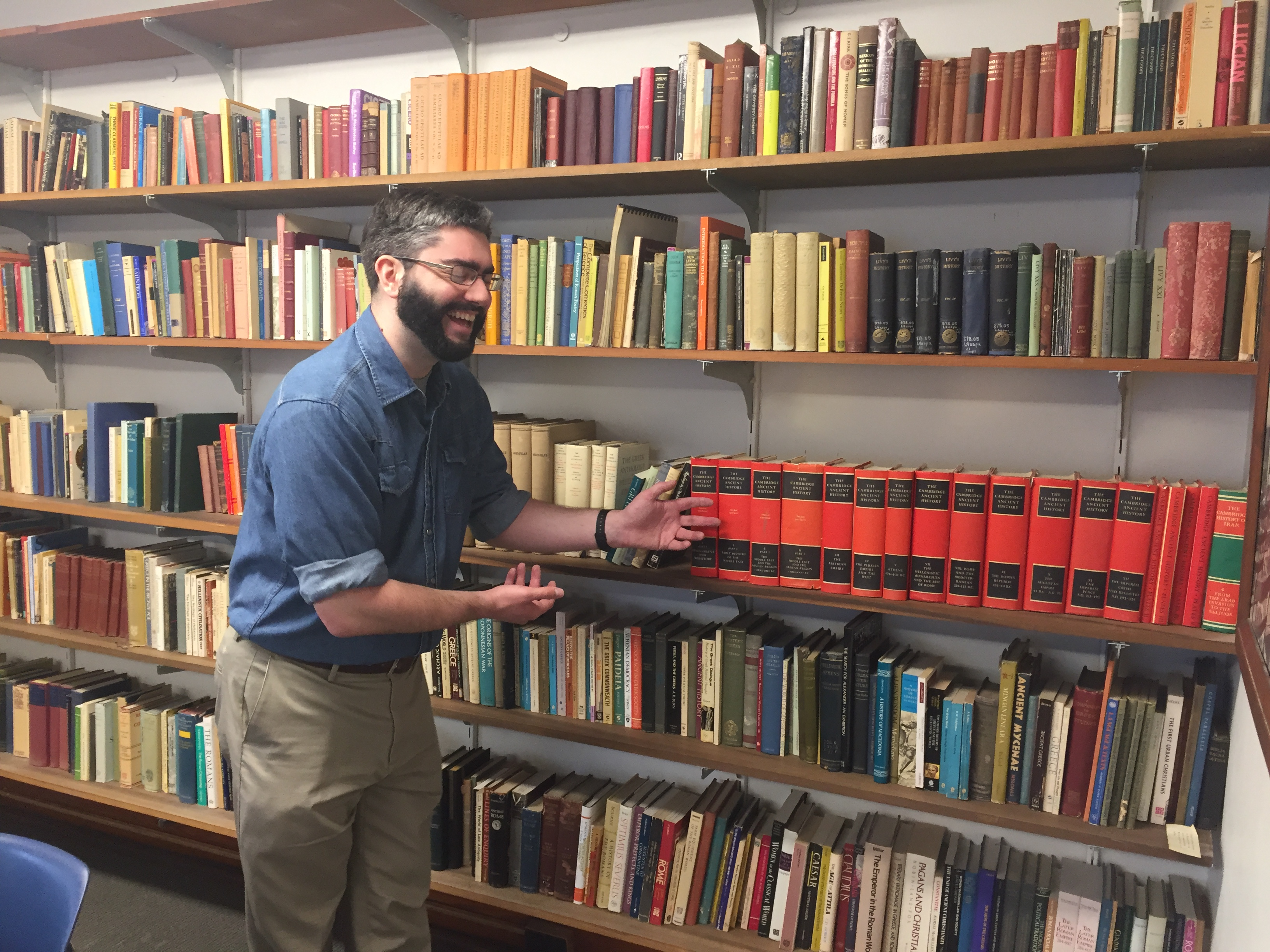 Dr. Paul Hay directs the reshelving and organizational operation.