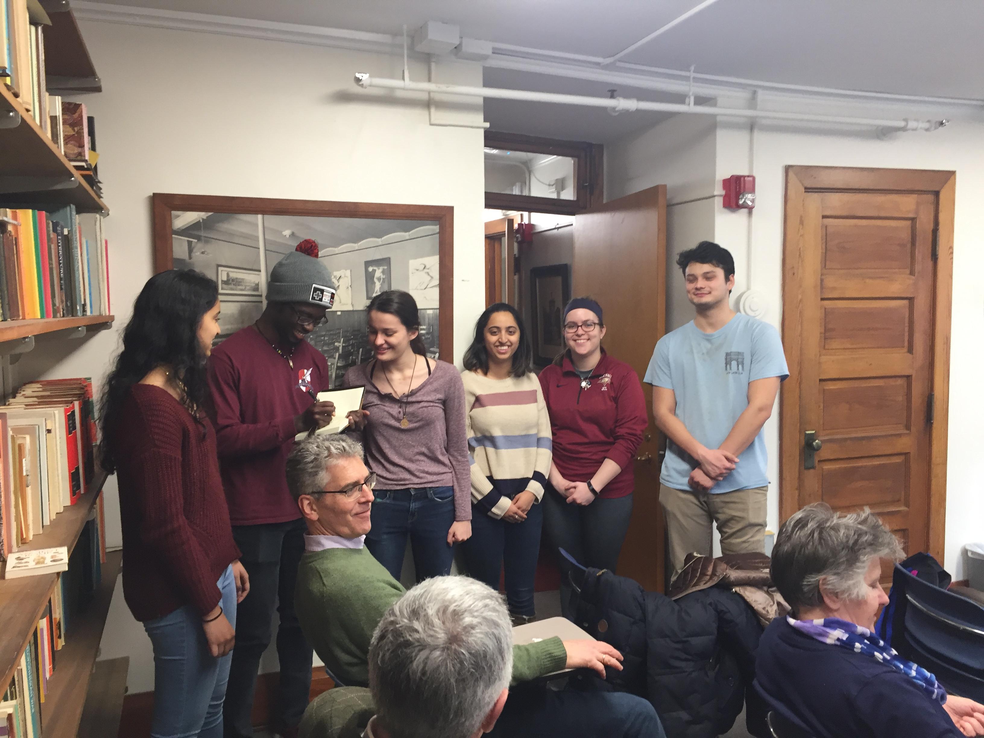New members of Eta Sigma Phi sign the member register (from L to R: Asha Ravichadran, Nana Yorke, Jillian White, Saloni Lad, Emma Ries, and Joshua Breckenridge)