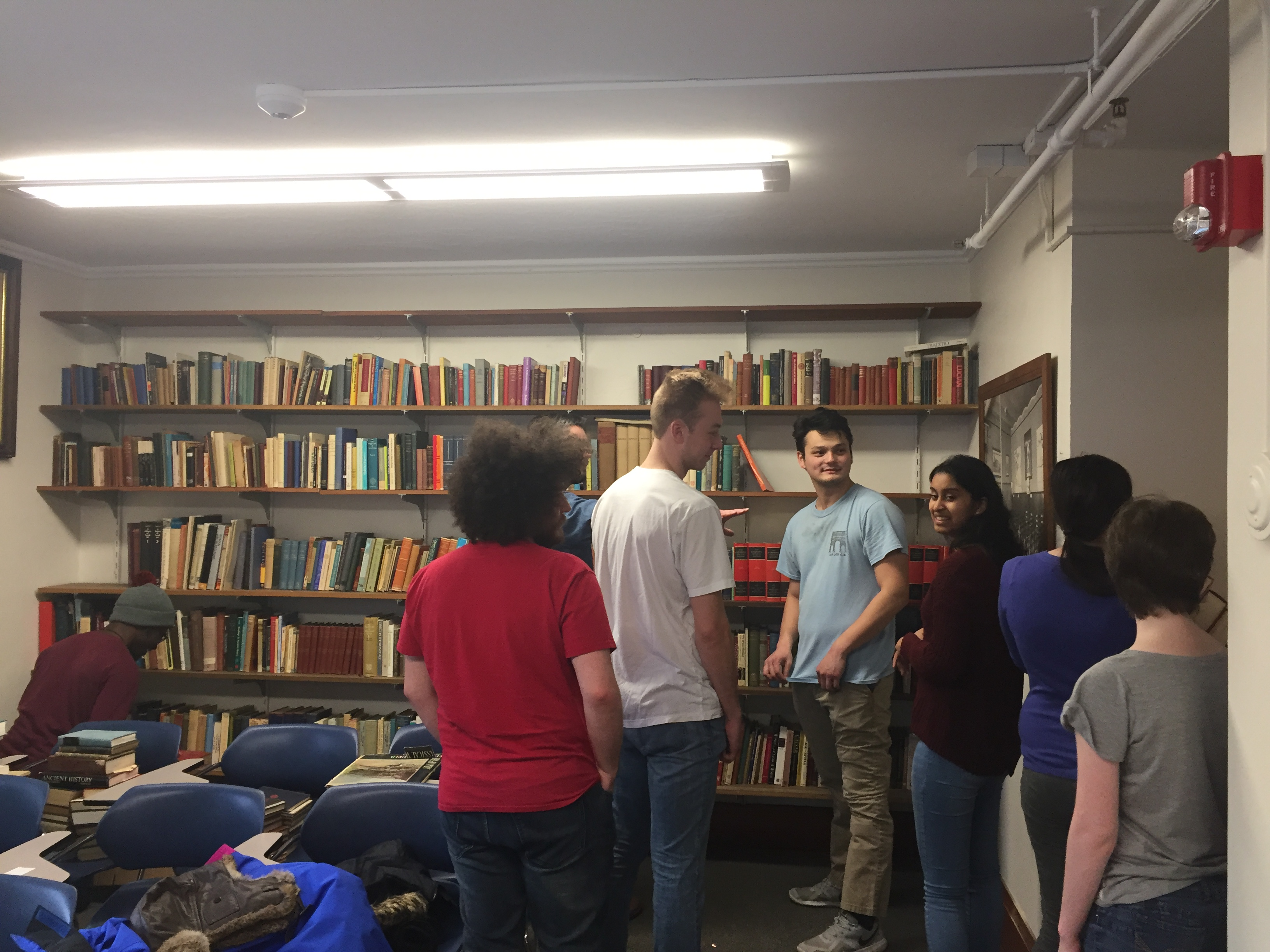Classics students help organize the department's books (from L to R: Nana Yorke, Adam Doros, Dr. Paul Hay in the back, Colin Hawkinson, Joshua Breckenridge, Asha Ravichadran, Dominica Rollins, and Justine Boyle).