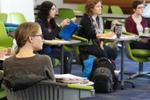 Students listen to an instructor during a class in the CWRU Department of English
