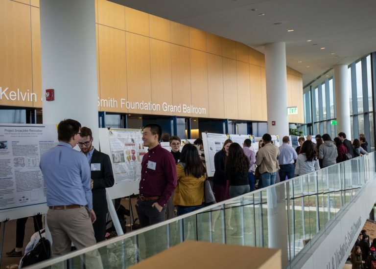 Students set up posters in Tinkham Veal University Center and many people attend.