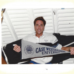 Future astronaut Donald Thomas holds a pennant that says Case Western Reserve University