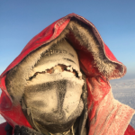 student's face is completely covered with mask and tape to prevent frostbite